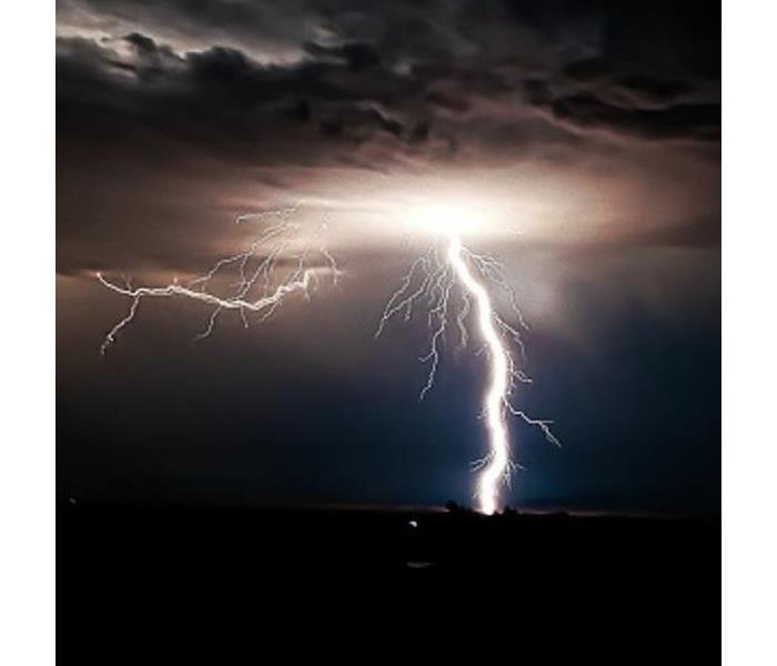 Cloud to ground lightning against night sky